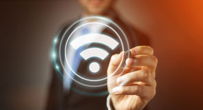 Businessman using free wifi hotspot interface 3D rendering Royalty Free Stock Image