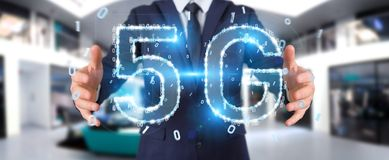 Businessman using 5G network digital hologram 3D rendering. Businessman on blurred background using 5G network digital hologram 3D rendering Stock Image