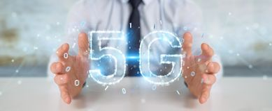 Businessman using 5G network digital hologram 3D rendering. Businessman on blurred background using 5G network digital hologram 3D rendering Royalty Free Stock Photo