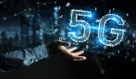 Businessman using 5G network digital hologram 3D rendering. Businessman on blurred background using 5G network digital hologram 3D rendering Stock Photography