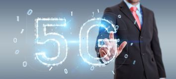 Businessman using 5G network digital hologram 3D rendering. Businessman on blurred background using 5G network digital hologram 3D rendering Stock Photos