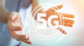 Businessman using 5G network interface 3D rendering. Businessman on blurred background using 5G network interface 3D rendering Royalty Free Stock Image