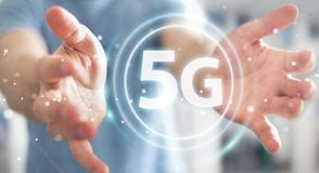Businessman using 5G network interface 3D rendering. Businessman on blurred background using 5G network interface 3D rendering Royalty Free Stock Photo