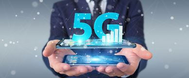 Businessman using 5G network with mobile phone 3D rendering. Businessman on blurred background using 5G network with mobile phone 3D rendering Stock Images