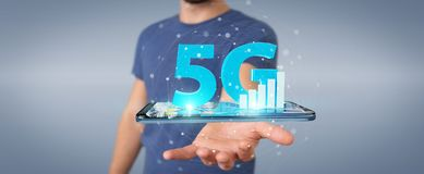 Businessman using 5G network with mobile phone 3D rendering. Businessman on blurred background using 5G network with mobile phone 3D rendering Stock Photography