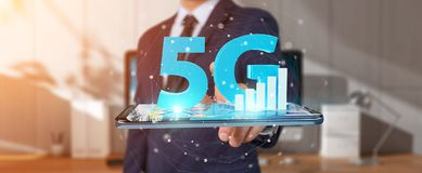 Businessman using 5G network with mobile phone 3D rendering. Businessman on blurred background using 5G network with mobile phone 3D rendering Stock Photos