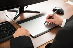 Businessman using graphic tablet Stock Image