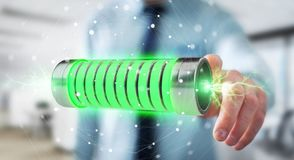 Businessman using green battery with lightnings 3D rendering. Businessman on blurred background using green battery with lightnings 3D rendering Stock Photos