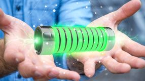 Businessman using green battery with lightnings 3D rendering Royalty Free Stock Photos