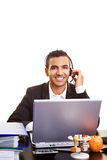 Businessman using headset Stock Photos
