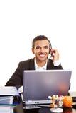 Businessman using headset Stock Photos