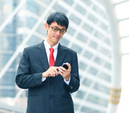 Businessman using his cell phone, portrait Stock Photography