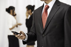 Businessman using his cellphone Royalty Free Stock Images