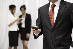 Businessman using his cellphone Royalty Free Stock Photo
