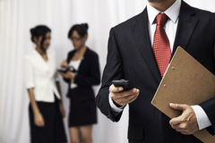Businessman using his cellphone Stock Images