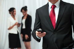 Businessman using his cellphone Stock Photo