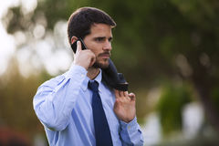 Businessman using his cellphone Royalty Free Stock Photos
