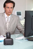 Businessman using his computer Stock Image