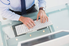 Businessman using his computer Stock Images