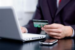 Businessman using his credit card. For an online transaction Royalty Free Stock Images