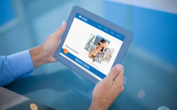 Businessman using his 3d tablet Royalty Free Stock Photos