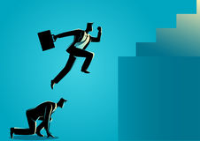 Free Businessman Using His Friend As A Stepping Stone To Jump Higher Royalty Free Stock Photography - 98879807