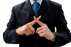 Businessman using his hands as cross. Businessman in dark gray suit using his hands as cross. Meaning wrong, fault, not correct, not allow, prohibit Stock Image
