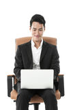 Businessman using his laptop Stock Photography
