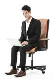 Businessman using his laptop Stock Images