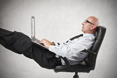 Businessman using his laptop stock photo