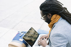Businessman using his laptop in the Street. Royalty Free Stock Photography