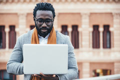 Businessman using his laptop in the Street. Royalty Free Stock Photo