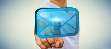 Businessman using his mailbox. Businessman holding a digital 3D email icon in his hand Royalty Free Stock Photo