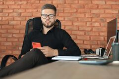 Free Businessman Using His Mobile Phone In The Office Stock Image - 181487201