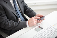 Businessman using his mobile phone Royalty Free Stock Photo