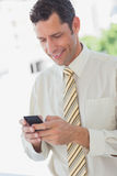 Businessman using his phone Stock Image