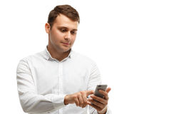 Businessman using his phone isolated on white Stock Photos
