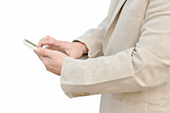 Businessman using his smart phone. Businessman in suit using his smart phone Stock Photo