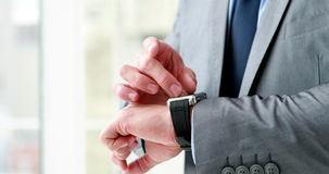 Businessman using his smart watch stock footage
