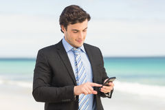 Businessman using his smartphone Stock Photography