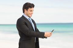 Businessman using his smartphone Royalty Free Stock Photos