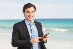 Businessman using his smartphone Stock Image
