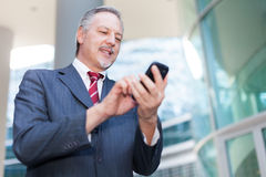 Businessman using his smartphone Stock Photo