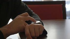 Businessman using his smartwatch stock video