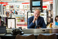 Businessman using his tablet at the airport Stock Images