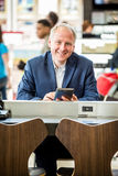 Businessman using his tablet at the airport Stock Photo