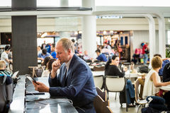 Businessman using his tablet at the airport Stock Image