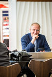 Businessman using his tablet at the airport Royalty Free Stock Photos