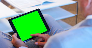 Businessman using his tablet stock footage