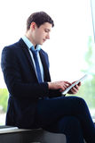 Businessman using his tablet Royalty Free Stock Photography